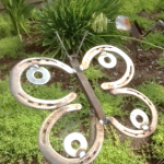 horse shoes and metal materials welded together to create a butterfly