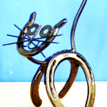Horse shoes and metal materials welded together to make a cat